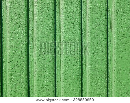 Green Paint Cracked. In Sunny Weather The Iron Gate. Vertical Lines