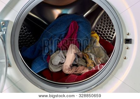 Dirty Laundry In The Washing Machine. Laundry, Cleanliness, Round Door.