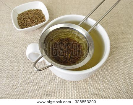 Tea From Caraway Seeds And Caraway Fruits In The Tea Strainer