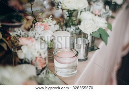 Candle, White  Flowers In Modern Glass Vase On Pink Centerpiece. Stylish Luxury Decor On Wedding Tab