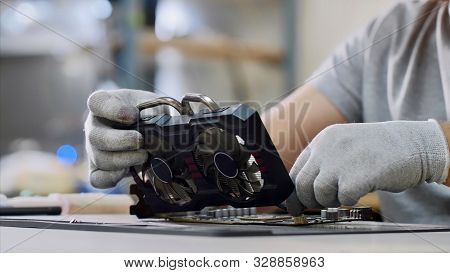 Repairman Fixing The Graphics Chipset At Workshop, Closeup.
