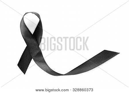 Black Ribbon On White Background, Top View. Funeral Symbol