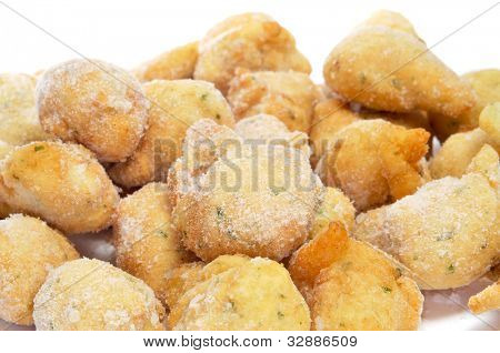 a pile of frozen cod fritters ready to fry