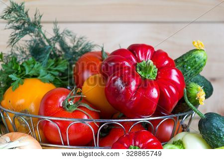 Close Up Vegetables Harvest In Wicker Basket On Wooden Background. Red And Yellow Pepper, Tomatoes,
