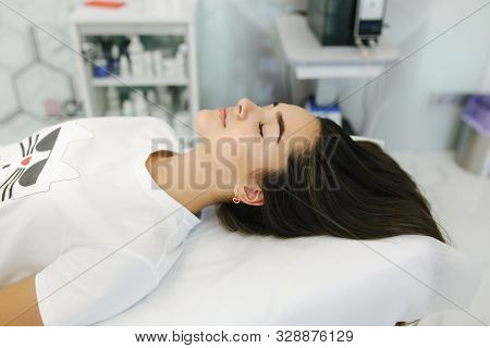 Young girl at Cosmetic Beauty Spa Clinic waiting for beauty procedure poster