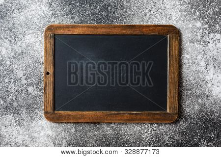 Small Empty Chalkboard On A Grey Textured Background. Blank. Blackboard Background. Blackboard Textu