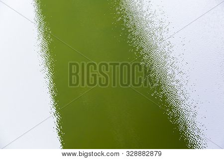 Green Water Surface With Ripples For Backgrounds