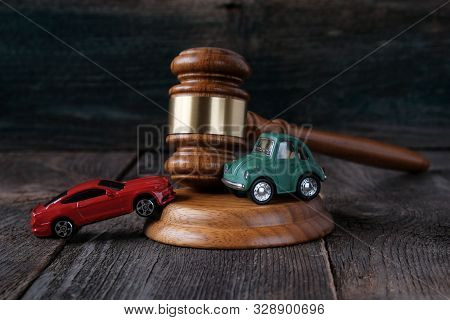 Kazan, Russia, October 8, 2019. Car Models And Judges Hammer On A Wooden Background, Concept Of Prot