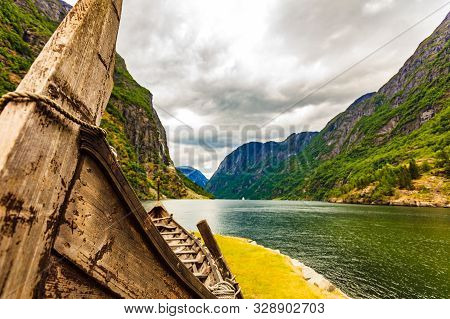 Old Viking Boat On Fjord Shore, Norway