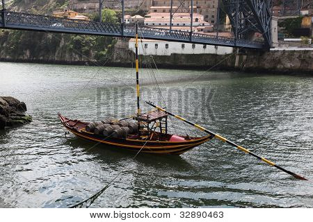 A traditional Rabelo boat on the Douro River - Porto - Portugal. Rabelo were traditionally used to transport barrels of port on the Douro river which there area is famously known for. poster