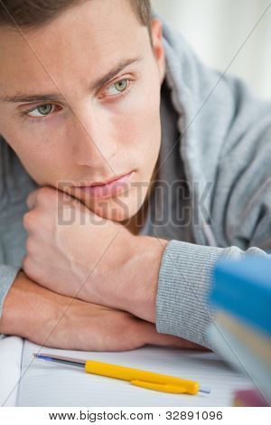 Close-up of a depressed student  on his desk