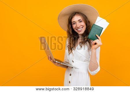 A Girl Buys Plane Tickets Over The Internet, A Stylish Lady Holds A Passport And Flight Tickets In T