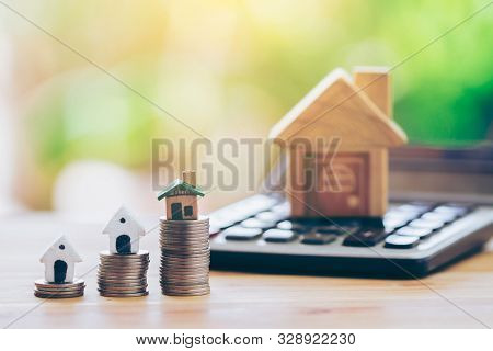 House Place On Coins. House Place On The Calculator. Planning Savings Money Of Coins To Buy A Home C