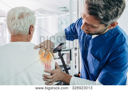 Physiotherapist Examines A Patient With Arthritis Of The Shoulder Joint.