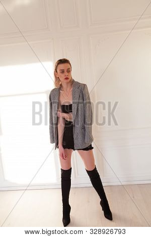 Porter Beautiful Fashionable Blonde Woman In Clothes And Boots