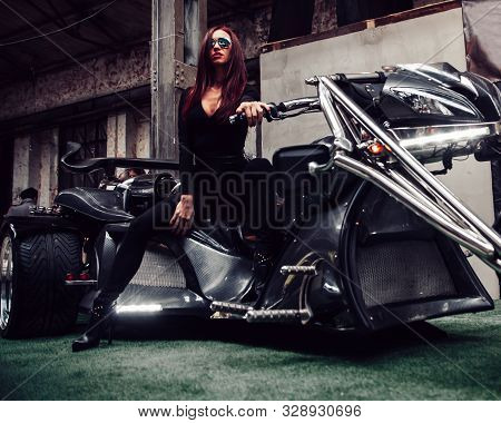 Fashionable Young Woman Posing Sitting On New Trike
