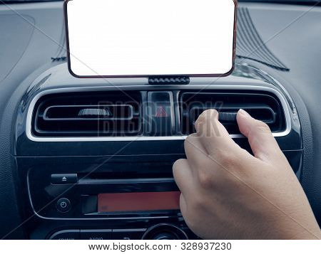 Close Up Image Of Adrivers Hand Adjusting Air Conditioner Using The Air Conditioning Tuner And The G