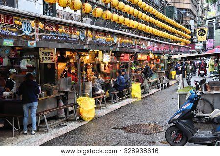 Keelung, Taiwan - November 23, 2018: People Visit Famous Miaokou Night Market In Daytime Keelung, Ta