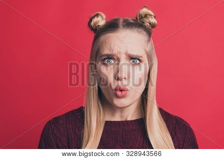 Close up photo of disappointed fearful astonished youngster with lips pouted learning bad news with disappointed facial expression isolated over red vivid color background poster