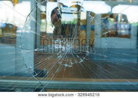 Broken Glass Pane. Smashed Blue Glass In Shop