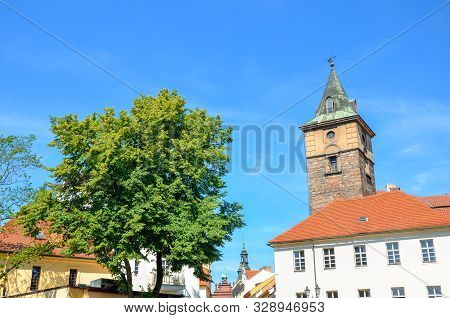 Historical Water Tower, Vodarenska Vez, In Pilsen, Czech Republic On A Sunny Day With Green Tree. Pl