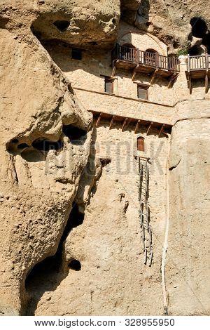 Monastery in the rock and hermits abode in Meteora near Kastraki village, Greece