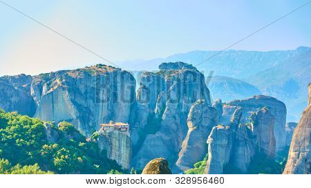 Panorama of Meteora rocks with The Monastery of Rousanou on the cliff, Greece -  Greek mountain landscape