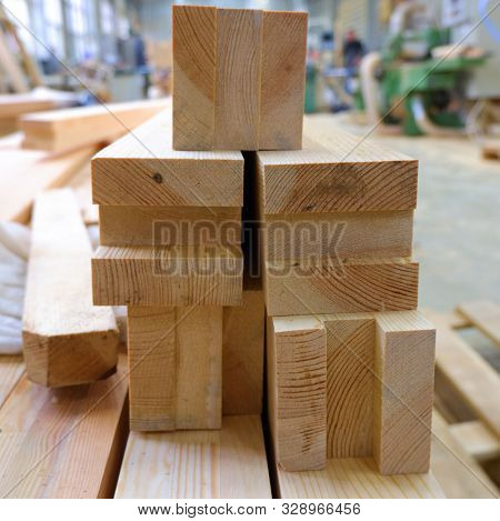 poster of View from butt of stack of three-layer wooden glued laminated timber beams from pine finger joint spliced boards for wooden windows