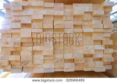 poster of Stack of two-layer wooden glued laminated timber beams from pine finger joint spliced boards for wooden windows