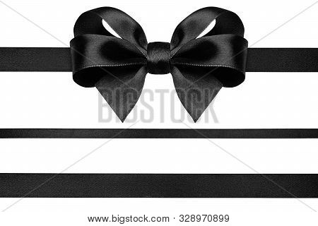 Black Ribbon With Gift Bow Isolated On White. Christmas Festive Bow Of Black Shiny Satin Ribbon And