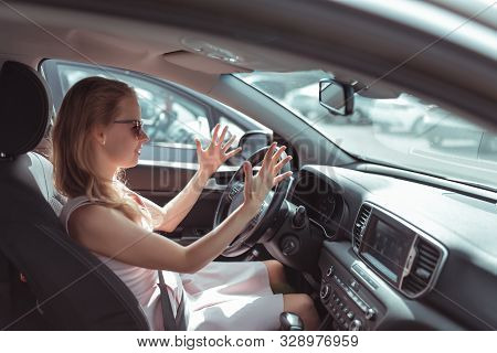 Girl Driving Car In Cabin. Hand Gesture Accident Signal Conflict, Emotions Stress Aggression Discont