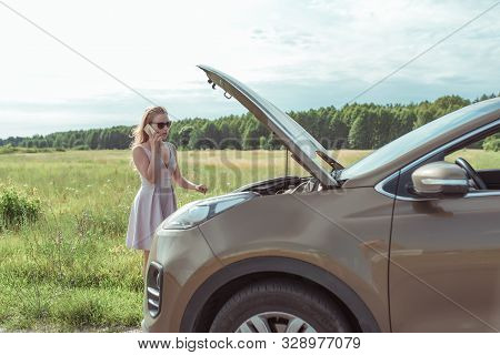 Girl Pink Dress, Car With Open Hood On Sidelines Summer Road Near Field, Background Grass Forest Car