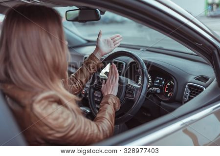 Girl driving car in cabin. Hand gesture accident horn signal, beep, conflict, emotion stress aggression discontent. Misunderstanding scandal and accident on road. Right-hand drive, left-hand drive. poster