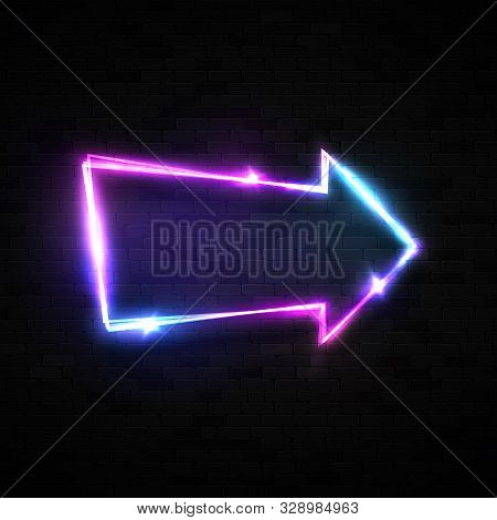 Neon Arrow Pointer On Black Brick Wall Background. Electric Arrow Symbol. Technology Glowing Led Lam