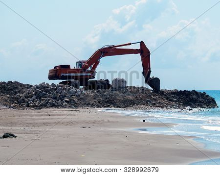 Excavator Digger Stone Working On Construction Site - Backhoe Loader On Beach Sea Ocean. Excavator D