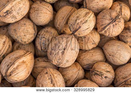 Walnuts. Whole Walnuts Background. Many Walnuts Close-up. Walnut Texture.