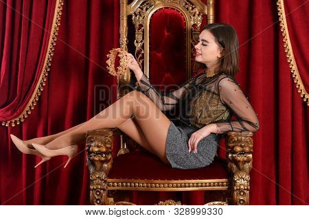 Portrait Of A Queen Sitting On Throne With Crown