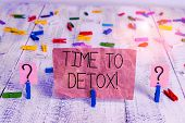 Text sign showing Time To Detox. Conceptual photo when you purify your body of toxins or stop consuming drug Scribbled and crumbling sheet with paper clips placed on the wooden table. poster