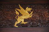 Golden Myth Animal Paksri Singha on luxury wood. poster