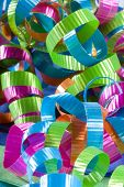 Multiple colors of curling ribbon shot for texture and background poster
