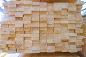 Stack of two-layer wooden glued laminated timber beams from pine finger joint spliced boards for wooden windows poster