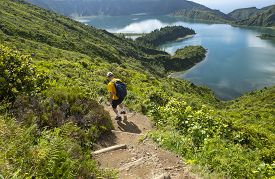 Man Hiking Down To Lagoa Do Fogo Or Lake Of Fire In Sao Miguel, Azores, Portugal