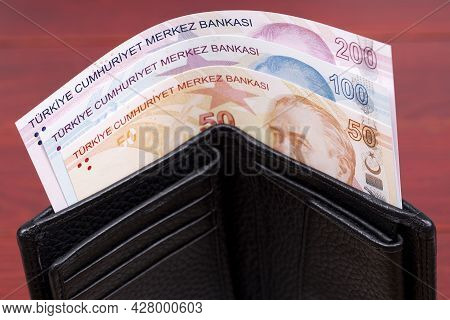 Turkish Lira In The Black Wallet On A Wooden Background