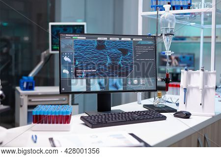 Computer With Microbiology Virus Expertise On Display Standing On Table During Medicine Biochemistry
