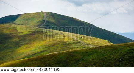 Rolling Hills Of Borzhava Mountains. Path Through Thetop Of The Ridge. Beautiful Nature Scenery With