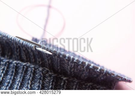 Knitting Project Underway. Blue Knitting And Knitting Needles On Light Background. Overhead Shot. Ha