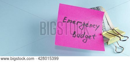 Banner With Us Dollars In Paper Clip On Pastel Blue Background With Note Written Emergency Fund : Co