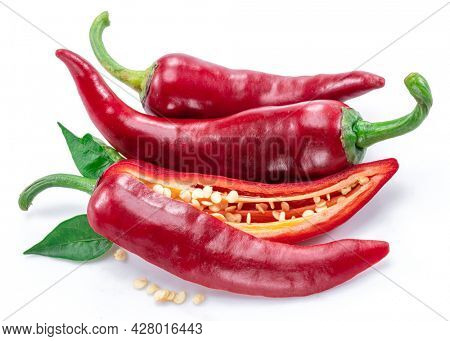 Fresh red chilli pepper and cross sections of chilli pepper with seeds isolated on white background.