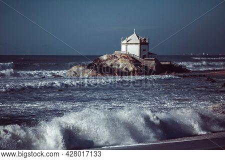 View of the Chapel Senhor da Pedra on Miramar Beach, Vila Nova de Gaia, Portugal.