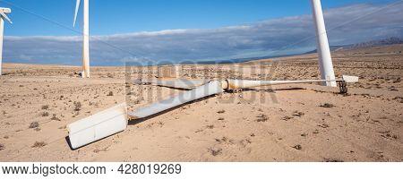 wind turbine in the desert with blue sky  background. wind mill farm in california desert, faulty broken turbine